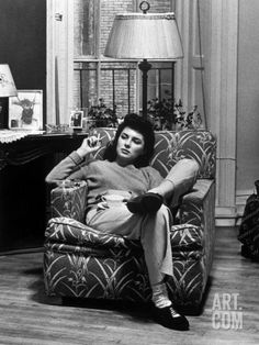 """Wife of Serviceman Sitting at Home, Smoking Cigarette, with Cover Story """"Lonely Wife."""" Premium Photographic Print By John Phillips"""