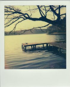 A jetty on a lake polaroid from 'The Impossible Project' by Ruvan Wijesooriya and Kasia Bobula. http://www.dazeddigital.com/photography/article/13435/1/the-impossible-project-ruvan-kasia