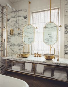 Marble walls : could do in marble look tiles. timber look tiled floor. gold brass taps and accents