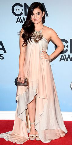 Lucy Hale in pink flowy halter gown with embellished yoke at the 47th CMA Awards