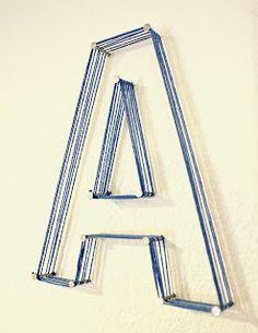 I could see doing this on a bulletin board, or on a piece of wood then framing the wood....Idea for one Letter of the alphabet on the wall