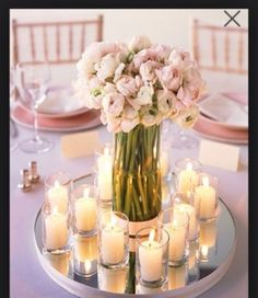 Head table idea...bridesmaids stick their bouquets in round vases surrounded by votive candles