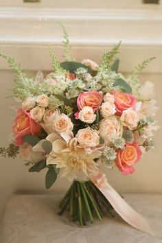 Wedding bouquet in coral and peach with miss piggy roses, café au lait dahlia…