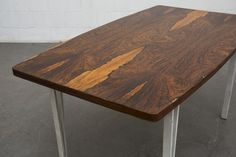 Modern Rosewood Bowed Top Dining Table with White Geometric Metal Frame