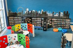 I like the temporary walls in this library.  They would allow you to create quiet areas or small group meeting spaces, and are colorful and playful.  Image issue du site Web http://demcointeriors.co.uk/images/1357557618DustonSchool.jpg