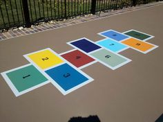 Something for everyone in the family...hopscotch painted off to the side of a multi-game court.