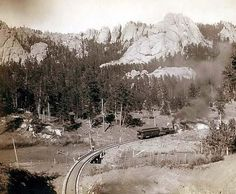 Bird's-eye view of a train on tracks, just beyond a marked curve. On Burlington and Missouri River Railway. Buckhorn Mountains in background. Photograph by John C. Grabill in Old Pictures, Old Photos, The Settlers, Into The West, Missouri River, Vintage Photographs, Vintage Photos, Vintage Art, Birds Eye View