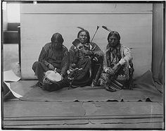Big Looking Glass (Comanche), Kookazachy (Kiowa Apache), Apiatan or Wooden Lance (Kiowa) – 1894 {Note: This group is displaying prayer items used in what is now referred to as the Native American Church.}