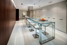 Minimalist Kitchen designed by ALBERTO/ESTEBAN - awarded Miele Exceptional Kitchen Award - featuring a 10' custom Starphire glass extended counter.  Available in lengths of 6', 8', and 10'.  #AlbertoEsteban, #AlbertoEstebanDesigners,  #AlbertoEstebanMiami