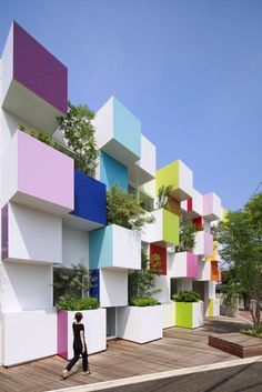 Trees sprout out of the rainbow-coloured cubes that make up the facade of this bank in northern Tokyo – the fourth building that architect Emmanuelle Moureaux has designed for Sugamo Shinkin Bank Architecture Design, Amazing Architecture, Contemporary Architecture, Landscape Architecture, Tokyo Architecture, Facade Design, Color In Architecture, Cubic Architecture, Contemporary Houses