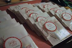 Glasine Christmas Treat Bags - love the red and white string. Would look great with brown paper bags.