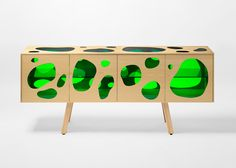 Brazilian duo Humberto and Fernando Campana have used green glass to fill blob-shaped gaps in this wooden cabinet for Spanish brand BD Barcelona Design
