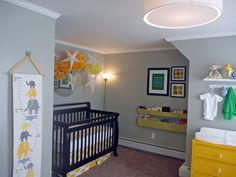 kids' room with grey walls, white trim, and espresso furniture. Yellow accents