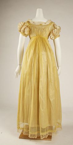 1811 Ball Gown, British. MET, C.I.66.38.1a, b. Net/sheer dress over satin underdress. Many more pictures at museum site.