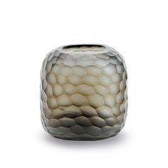This Somba vase from Guaxs brings natural style to any home. £248. www.amara.co.uk