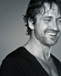 Gerard Butler, one of the most attractive actors out there. Do as he wishes and smile back ;)