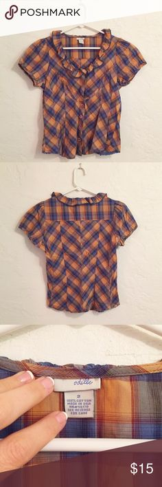 Anthropologie Odille plaid top This beautiful top is in EUC size 2 Odille from Anrhropologie in blue and gold.  The last picture is from years ago to show fit and the top has since been in my closet.  Priced to sell- looking to clean out said closet.  Please no trades or PP.  All bundles are 20% off!  Thanks for looking! Anthropologie Tops Button Down Shirts