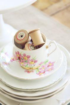 Vintage teacup and saucer filled with vintage thread spools~  blondiensc.etsy.com