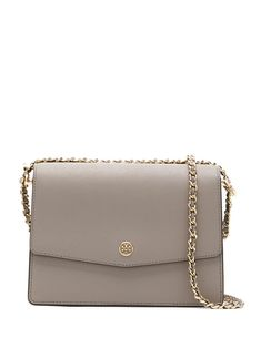 Grey calf leather Robinson shoulder bag from Tory Burch featuring a front logo plaque, a foldover top with magnetic closure, an internal zipped pocket and a gold-tone chain shoulder strap. Trendy Purses, Cute Purses, Purses And Bags, Designer Purses And Handbags, Luxury Purses, Luxury Bags, Cute Handbags, Women's Handbags, Prada