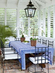 Dress windows with shutters for an easy, tropical style and low-maintenance appeal. - shutters instead of blinds faster to open close every day. Beautiful white shutters give this patio area the feel of the tropics. Budget Blinds of Benton Style Tropical, Tropical Home Decor, Tropical Houses, Coastal Style, Southern Style, Outdoor Rooms, Outdoor Dining, Outdoor Furniture Sets, Outdoor Decor