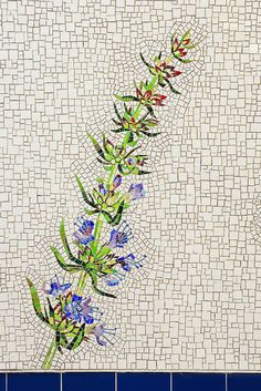 Mosaic flower...love the concentration of very small pieces used around the flowers, followed by randomly scattered small, medium and large mosaic pieces as the main background.  The flower cannot help but be the focal point.