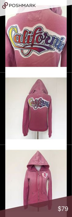 """Womens True Religion Pink Rainbow California Small Womens True Religion Pink Rainbow California Surfer Zip Up Hoodie Jacket Small  Rare! This hoodie is comfortable and cute. Rainbow California applique on the back of it and a rainbow and surfer True Religion applique on the front.  Size: Small Bust (flat): 18"""" - Stretches to 20""""  Length (from shoulder): 26""""  Sleeve (from armpit) 19""""  100% Cotton.  Please check out my Trixy Xchange store for more surfer hoodies! :) True Religion Tops…"""