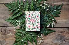 Notebook with flower watercolor illustration by TheTwentyFingers