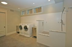 laundry/mudroom with a dog wash station