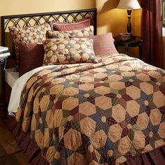 Tea Star quilt and bedding by VHC Brands brings a primitive cabin delight to the home with its 6-pointed plaid stars and hexagons. The patterns and colors of brick red, moss green, and black plaid on each star shift and change so that no adjacent star is the same. This subtle diversity adds a unique flair to its overall composition. Reverses to brick red, forest green, and gold tartan plaid.