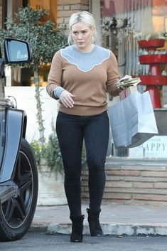 Hilary Duff wearing Veronica Beard Atty Sweater and Laurence Dacade Nico Ankle Boots in Black Suede Hilary Duff Style, Veronica Beard, In Pantyhose, Celebs, Celebrities, The Duff, Star Fashion, Pullover Sweaters, Ideias Fashion