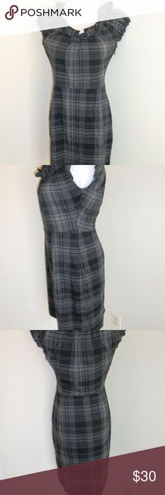 Dress Barn Black Gray Plaid Career Dress 4 EUC Super cute career dress by Dress Barn in size 4, worn only a few times.  There are belt strings on dress but they are only connected by one string, shown in one of the pics.  Dress was purchased this way from Dress Barn.  Can easily be fixed if desired or taken off.  Can be worn with a cute accent belt and heels.  Ruffle neckline with slit in back. Dress Barn Dresses