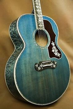 Thinking of how to learn guitar without paying such an enormous amount on an instructor? This article will prove that learning to play and master a guitar need not be expensive. Blue Acoustic Guitar, Custom Acoustic Guitars, Gibson Acoustic, Gibson Guitars, Blue Guitar, Easy Guitar, Cool Guitar, Guitar Tips, Simple Guitar