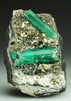 A neat contrast of emeralds with Pyrite from the Chivor Mine, Colombia. Crystal Classics Minerals
