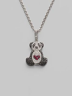 I have a panda necklace like this. It doesn't have a heart on it though. I love pandas because they are the mascot of Childplace, where I was adopted from.