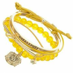 Harry Potter Five-Piece 'Hufflepuff' Bracelet Set. These whimsical bracelets let you celebrate your favorite magical series with wrist-accessorizing flair. Â Includes five bracelets Stacked: W Zinc alloy / leather / plastic Imported Harry Potter Welt, Bijoux Harry Potter, Harry Potter Accessories, Hufflepuff Merchandise, Harry Potter Merchandise, Harry Potter Outfits, Harry Potter Stuff, Arm Bracelets, Bracelet Set