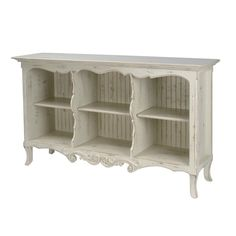 { Console / Sofa Table - French Country Console } Finished in distressed white with scroll carvings and scalloped edges, the French Country Console has an elegant, antique look. Features 3 compartments with beadboard interior back and 3 adjustable shelves. Made in the USA.