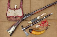 Beautiful kit. Possibles bag with patch knife; awesome longrifle; belt knife; gorgeous tomahawk; tool; ball patching strip; antiqued powder horn; antler powder measure.