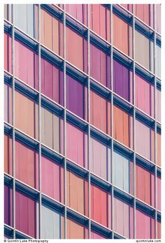 GSW Headquarters, Berlin, Germany. The windows are polychromatic pastel hues of orange and rose when the window shades are closed. Built 1999. Architect: Sauerbruch Hutton. Photo. Quintin Lake