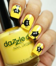 black cat nail art on yellow polish