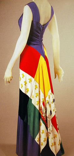 Dress by Elsa Schiaparelli, 1940. The dress is made up from silk scarves printed with the flag of the Royal des Vaisseaux. It was imported into the United States by Bonwit Teller. Philadelphia Museum of Art - Collections Object : Woman's Evening Dress