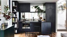 The Brunswick kitchen by Neometro utilises illusions of space – from the mirrored splashback to the grey colour palette.