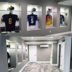 Discover a secret spot in the home with the top 60 best basement man cave design ideas for men. Explore cool manly home interiors. Grey Walls With Sports Jerseys Mens Basement Man Cave Designs
