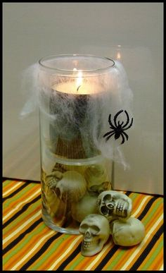 Make a Spooky Candle Holder (Note: A small candle holder is inside a larger one. Also, the spider webbing is NOT above the flame--it's cascading down the side.)