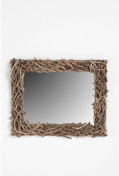 Wood (obviously), Mirror, research techniques for lightening the branches. At most $50. Urban Outfitters online for $149.00