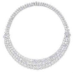 AN IMPORTANT DIAMOND NECKLACE, BY BULGARI    THE HIGHLY ARTICULATED NECKLACE SET TO THE FRONT WITH THREE GRADUATED BRILLIANT-CUT DIAMOND SWAGS, JOINED BY PEAR AND BRILLIANT-CUT DIAMOND FLOWERHEADS, TO THE BRILLIANT-CUT DIAMOND BACKCHAIN, MOUNTED IN PLATINUM, 41.0 CM LONG, IN GREEN LEATHER BULGARI CASE