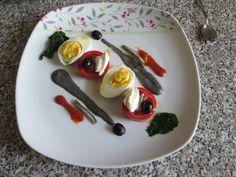Tomates anchois et mascarpone oeuf dur olive noir avec sauce noir de calamar /Gino D'Aquino