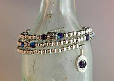 Wrap style, pewter with SS overlay beads, Tanzanite hue Czech firestones.