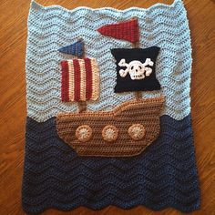 Too cute! The perfect baby blanket for a little boy! Hand-crocheted in extra soft yarns...blues, Browns, black and red. Adorable! This blanket is