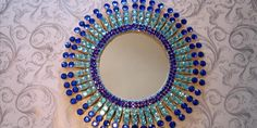 Are you in the mood to make an amazing, easy DIY craft that will really decor your house and makes an amazing gift? Well, why not make this super cool Starburst mirror that is super cheap and you can personalize with other objects such as yarn and glitter and more! This is a fun, easy craft to make