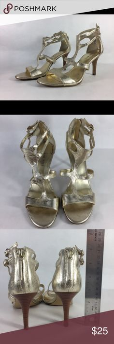 Nine West Gold 🌟 T-Strap Heeled Sandal Nine West gold 💫 t-strap heeled sandal. Gently worn, some wear on the inside of shoe. I can provide more images 📸 upon request. Great sandal that works in the office 👩🏫 or a night out 🌃 Gold goes with everything 👌 Mid height heel (about 3 inches) provides comfort but still sexy 💅 Dance your ass off all night 💃 Treat yo self. Nine West Shoes Heels